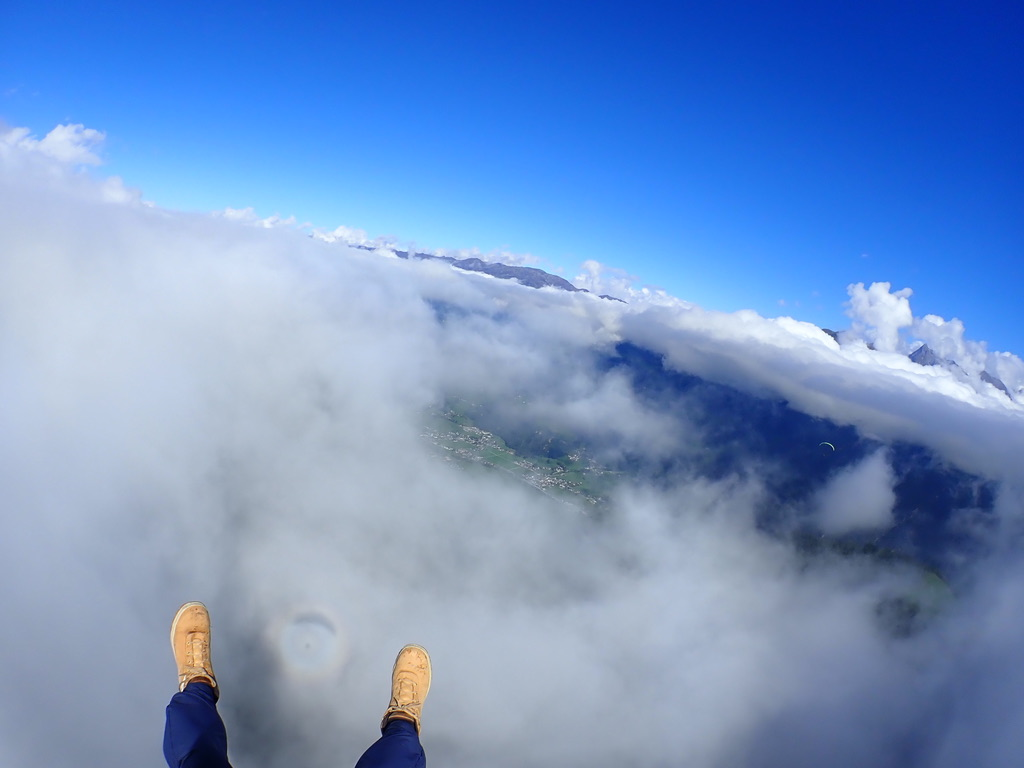 Tandem- Paragliding above the clouds